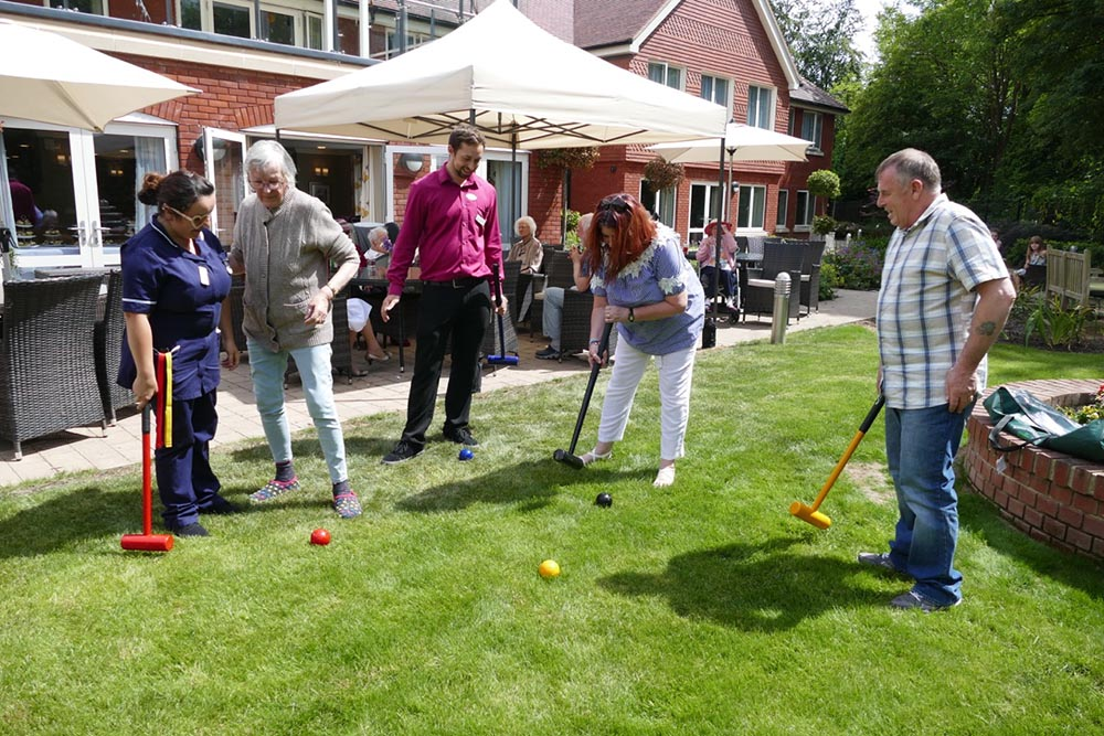 Game of croquet for residents and staff