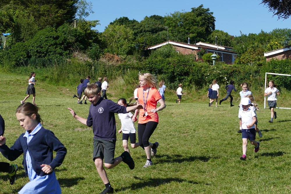 Toni Holness setting a good example to the pupils on the early morning run