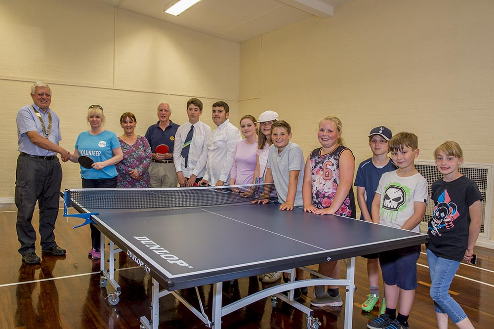 Mayor Lisa Farrell accompanied by Youth Centre colleague XXX accepts the new Table Tennis Table from Marlborough Rotary President Cedric Hollingsworth and Martin Luxford along with some of the Youth Centre's regular attendees