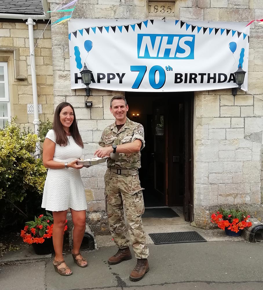 Bedwyn Partner Dr Anne Woods shares celebratory 'NHS at 70' birthday cake with local resident Lt Col Alex Freeborn