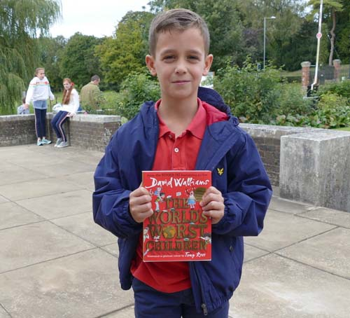 Oliver (10) with his signed copy of 'The World's Worst Children'