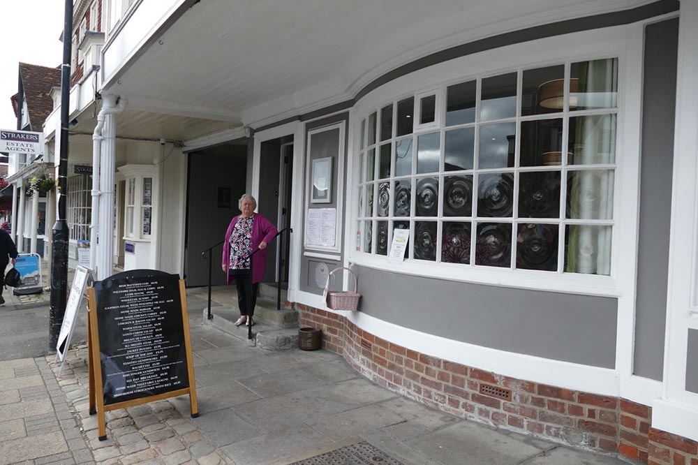 Jackie Dicks, Manager of The White Harte in the Conservative Club outside the newly refurbished building
