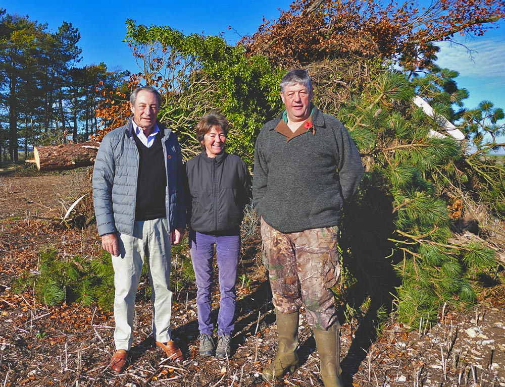 Ken Carter, Jilly Carter and Sid Vincent in front of the Rockley Beacon