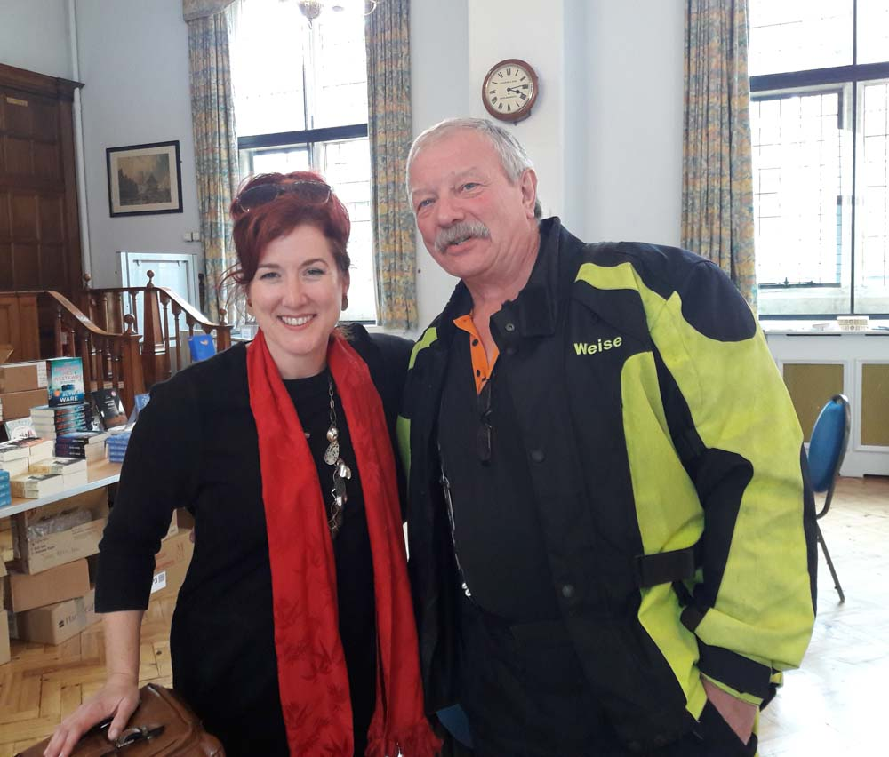 Lois Pryce with fellow biker in the LitFest cafe at the Town Hall