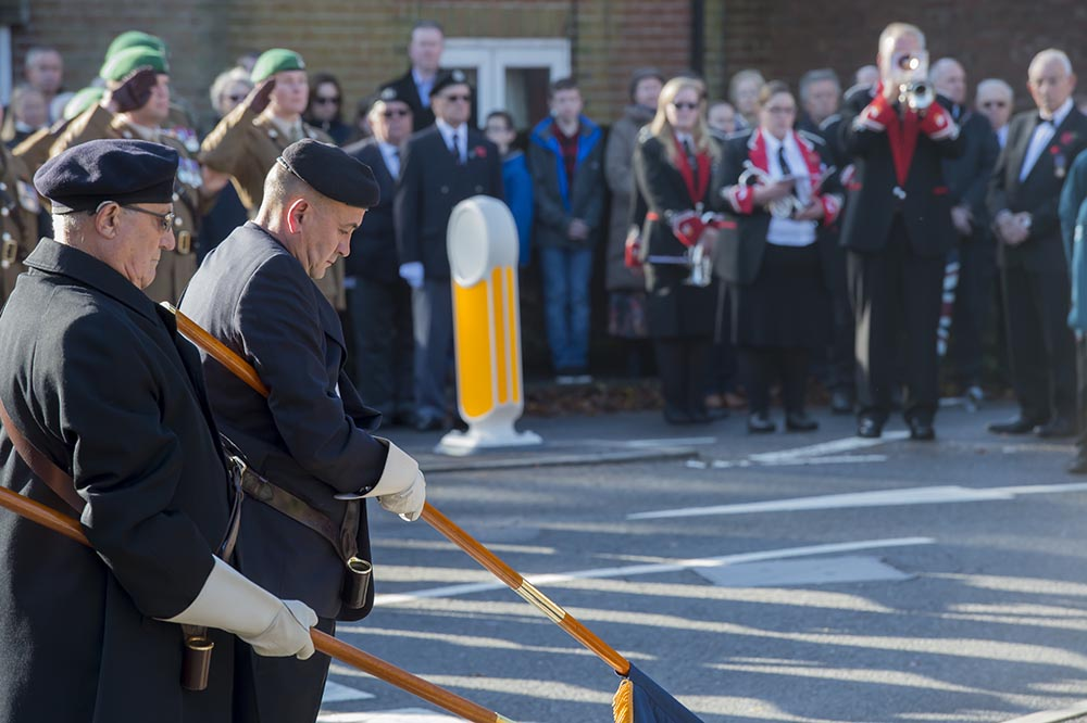 The Last Post rings out as Colours are lowered during the Remembrance Parade at the Barn Street War Memorial
