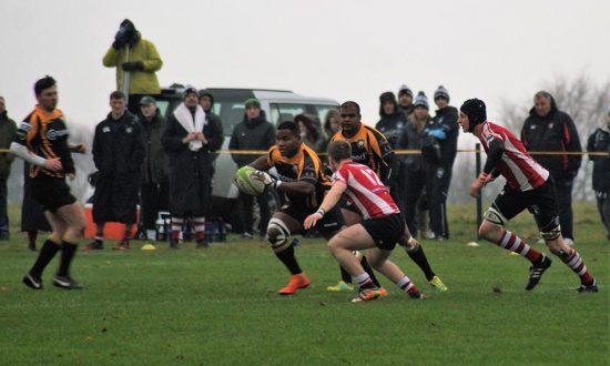 Avenai Cakaunitavuki attempts to break through the Bassett defence supported by Garth Bari and Tom West