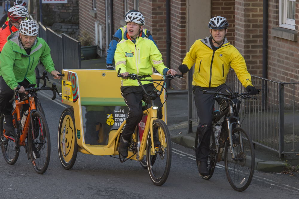 Matt, Harry, the Rickshaw and team pedal up London Road towards the High Street