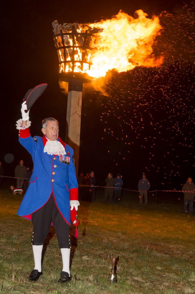 Town Crier Mike Tupman in 'Shout' in front of the Beacon