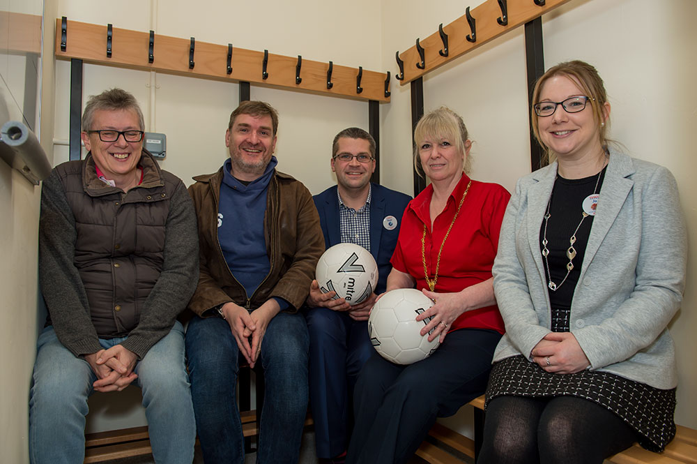 Mayor Lisa Farrell (2nd from right), Marlborough Tesco manager Matt Jones (also holding a football) with colleague Jo Bayliffe check out the newly equipped changing rooms for size with MYFC's John Evans (vice chair - left) and Stuart Slater (chair)