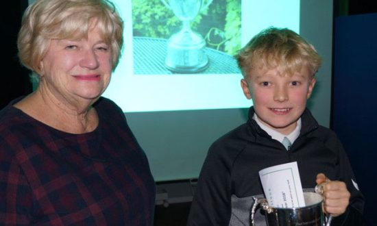 Oscar being presented with the Robert Hill trophy on Presentation Night by Rosie Hill, wife of the late Robert Hill