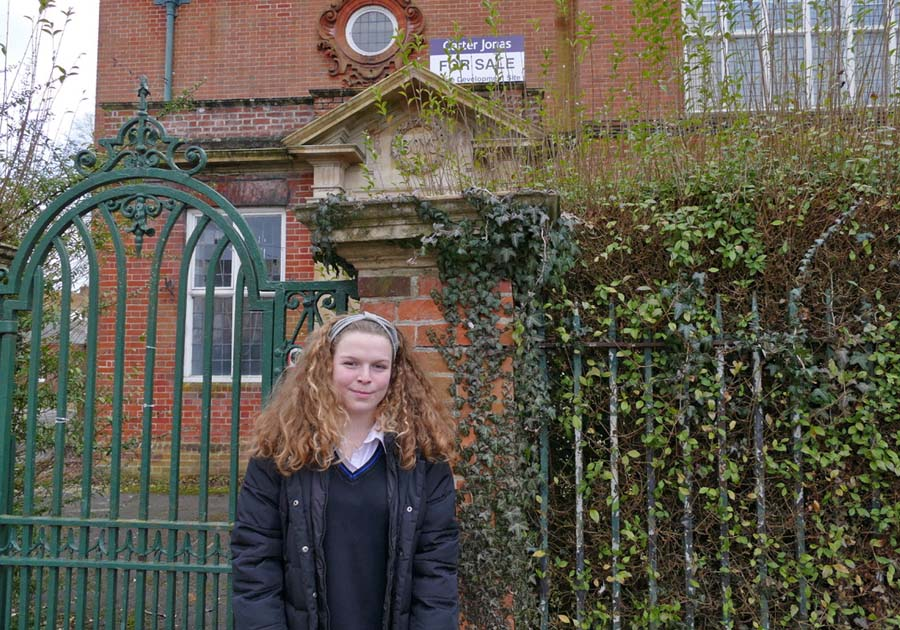 Ruby Pike outside St.Peter's School building