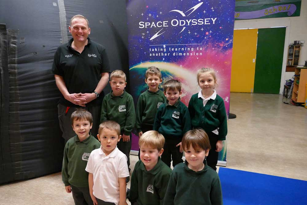 Simon Ould with Pewsey Primary reception class pupils outside the planetarium dome