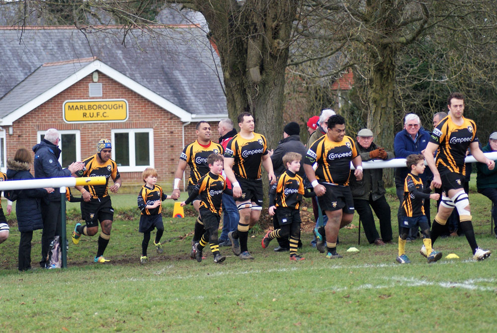 minis lead first team players onto the pitch