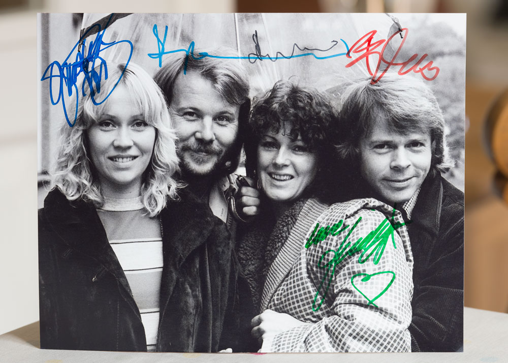 Classic black & white Abba pic, signed by all, and again by Frida