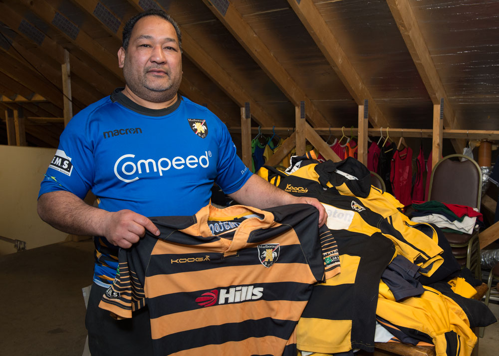 Marlborough Rugby Club's Director of Coaching Elisi Vunipola with one of the piles of surplus kit to be sent to Tonga