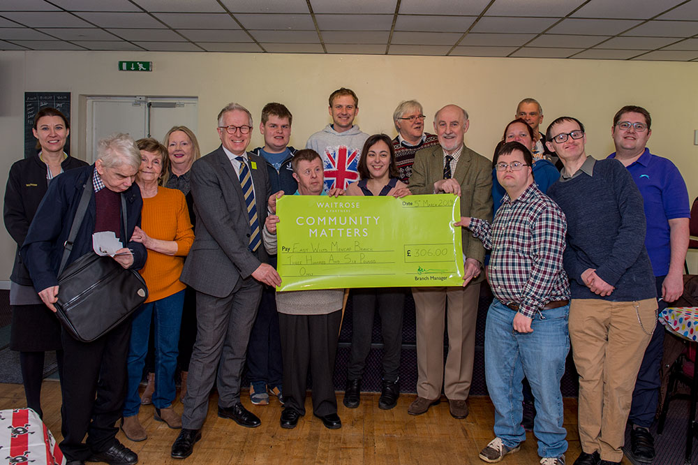 Cllr Noel Barrett-Morton accepts the large green cheque on behalf of the group from Marlborough Waitrose manager, Ian Burdekin and Community Champion, Lisa Wakeham