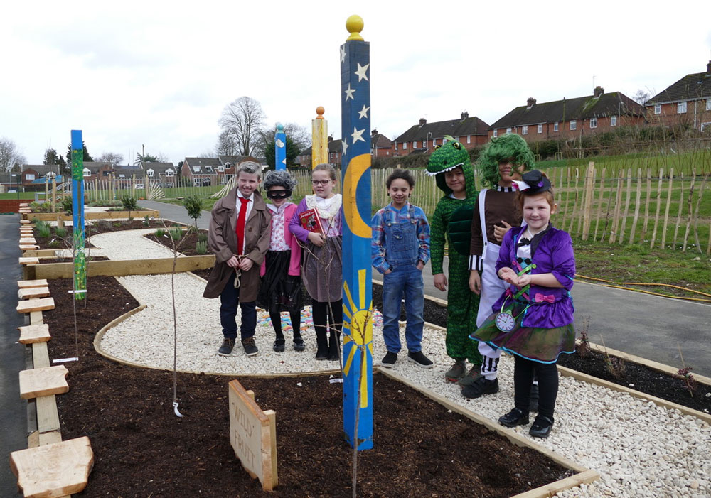 World Book Day characters enjoy the new garden at Marlborough St Mary's