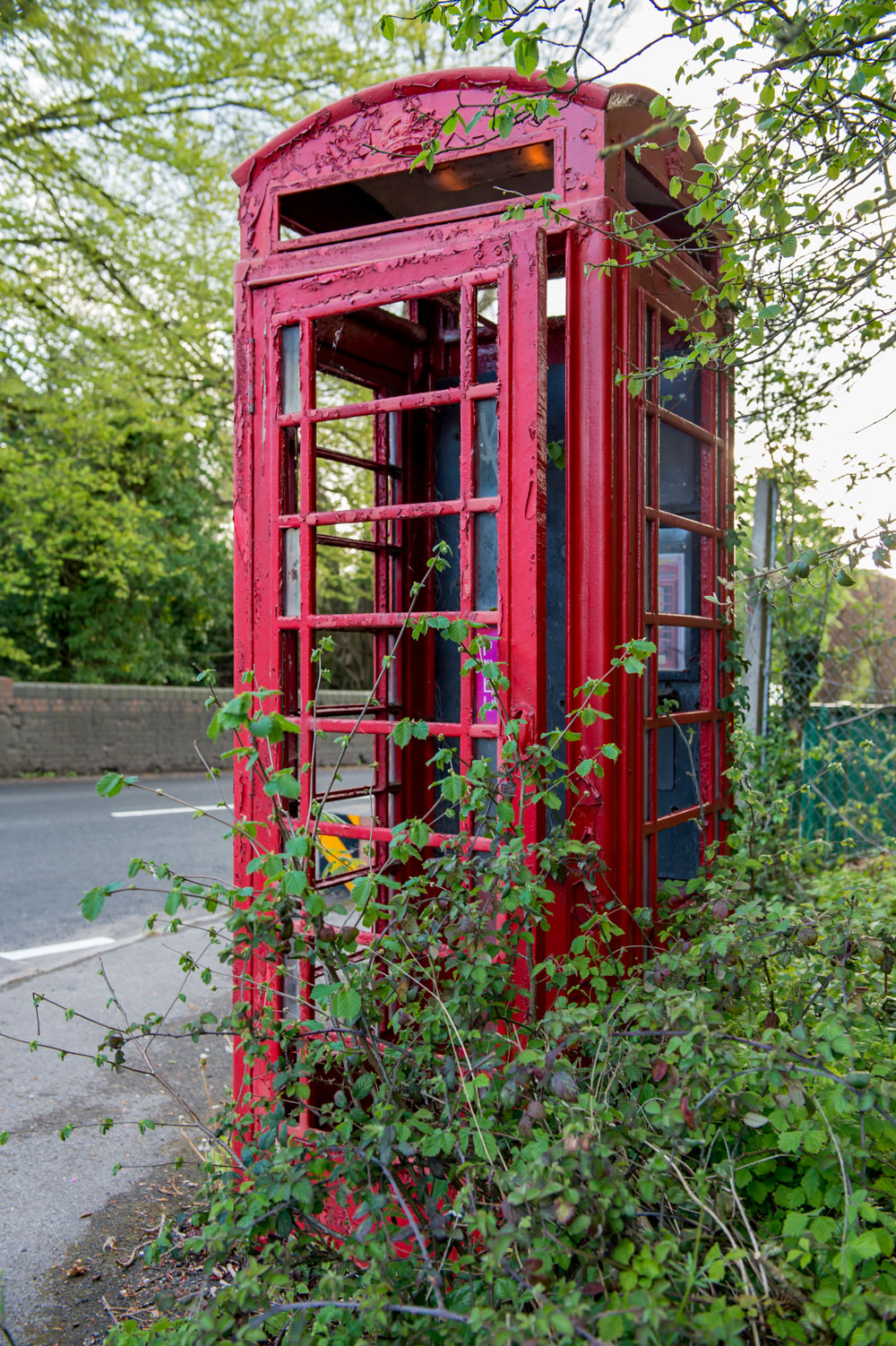 Redundant telephone box on the corner of Chopping Knife Lane - 'the lights are on but nobody's in' (unless you are a weed)