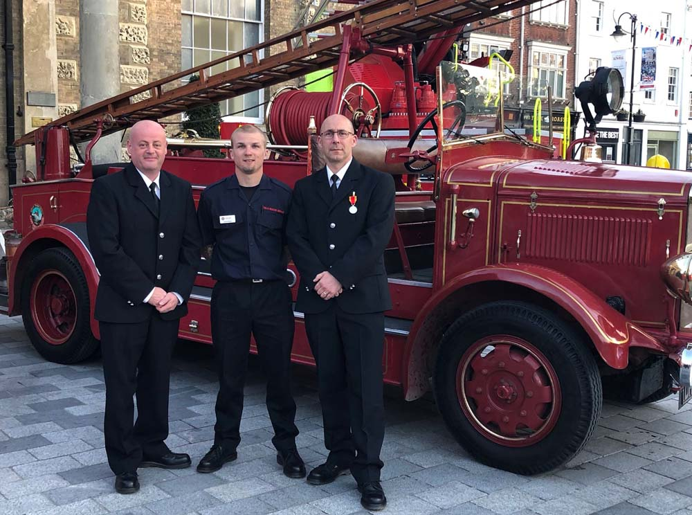 Mark with his medal & Marlborough colleagues who attended the ceremony - and ancient fire engine