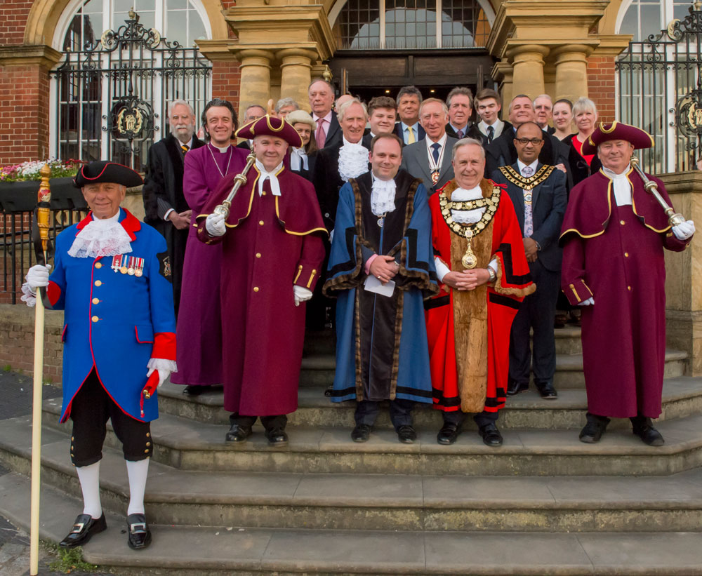 Marlborough's new Mayor, Cllr Mervyn Hall accompanied by the new Deputy Mayor, Cllr Mark Cooper, the Bishop of Ramsbury, The Right Revd Dr Andrew Rumsey, The High Sherriff of Wiltshire David Scott and Mrs Letitia Scott, Deputy Lieutenant Dr David Hemery with Town Councillors assembled on the steps of the Town Hall