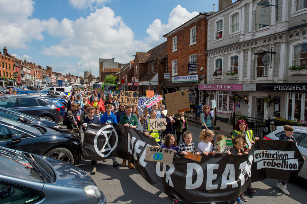 Extinction Rebellion marchers in Marlborough High Street extending down most of one side