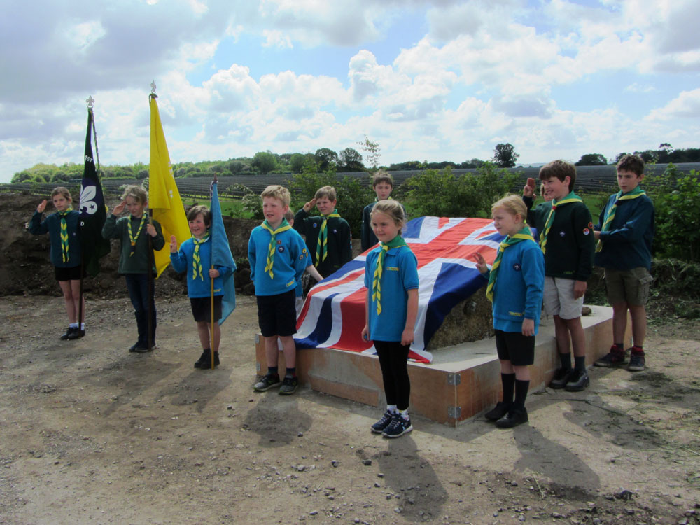 1st Ramsbury Scout Group line up for the dedication of the Information Board at Ramsbury Airfield