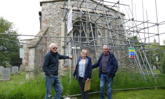 Baydon parishioners David Hill, Helen and Peter Chambers outside the propped up chancel wall at Baydon St Nicholas Church