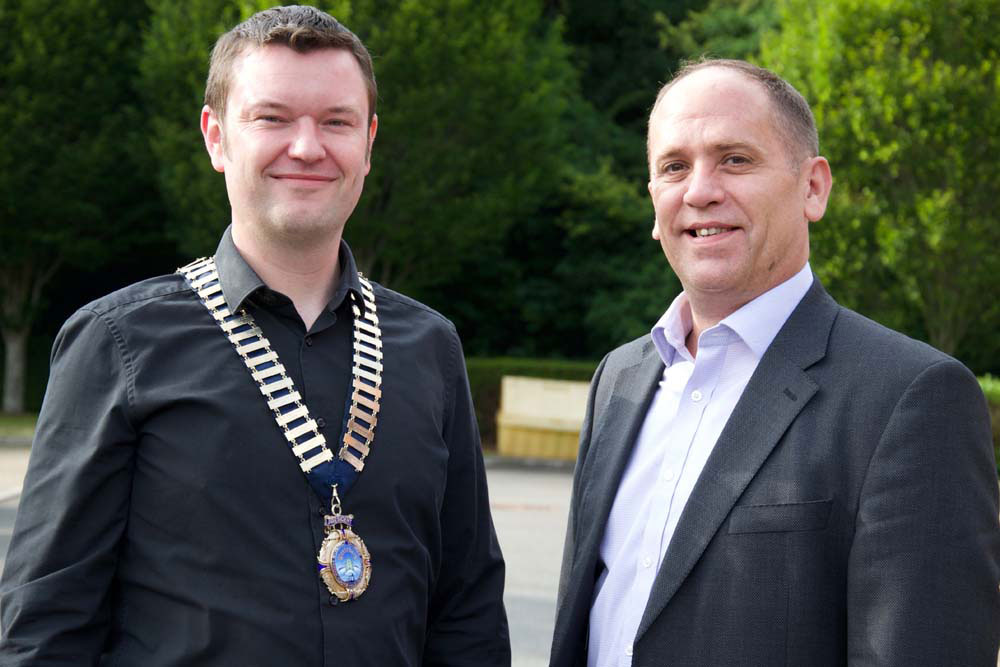New Chamber President Dave Jones (left) with outgoing President Alex Minoudis