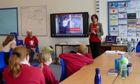 Fidelma Meehan and Jennifer Brisker from Save the Children speaking to Year 6 pupils at Marlborough St Marys
