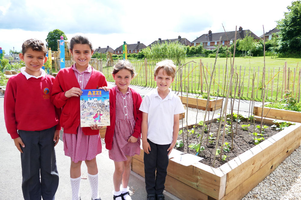 Marlborough St Mary's pupils with the graphic novel Azzi in Between and the runner beans they are growing