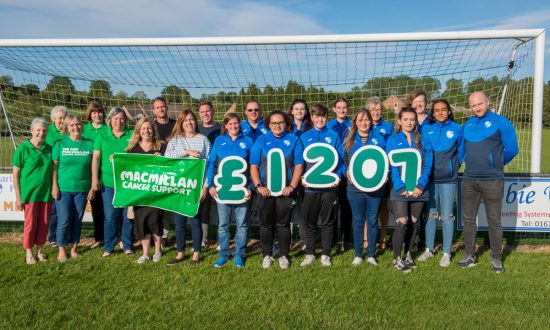 Macmillan Marlborough representatives Rose Martin, Kirsty Martin, Sandra Bull, Janet Buck and Vanessa Hillier (in green T-shirts) together with members of the current Ladies and Veterans teams celebrate the success of the recent charity fundraiser match showing clearly how much was raised