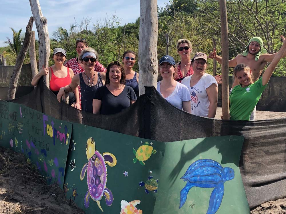 Midlifers taking part in turtle conservation work - with young local help