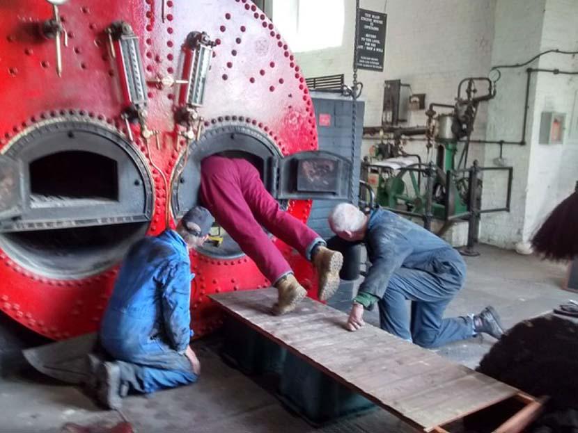 Volunteers at work on the problem boiler