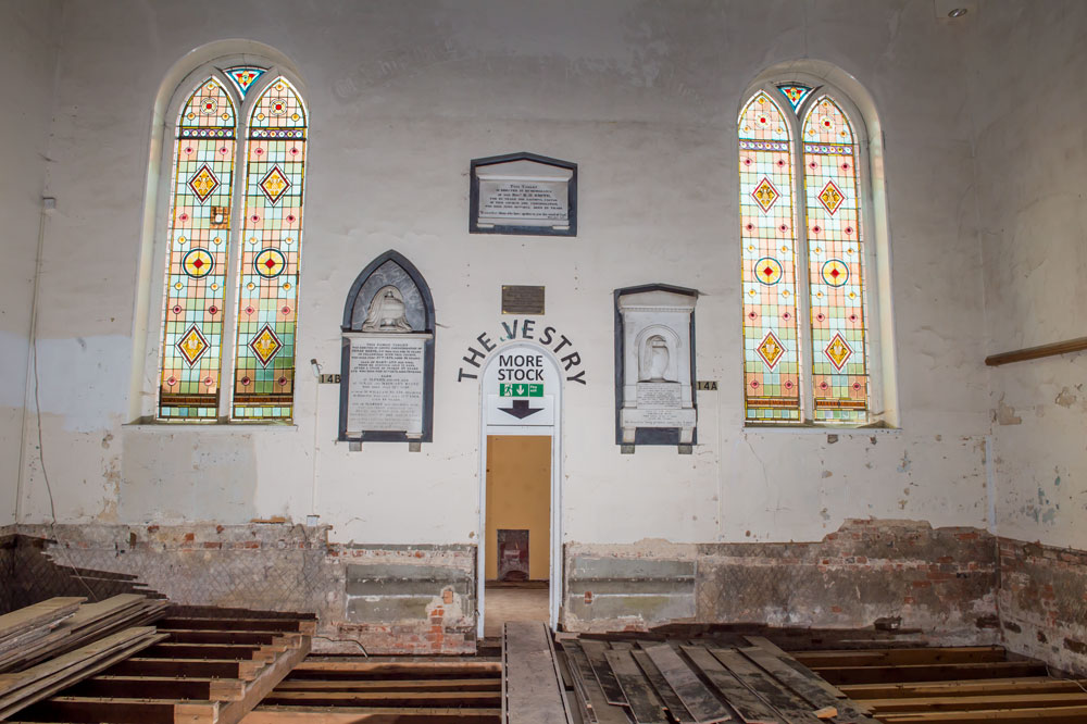 Stand glass windows at the Western end of the old Chapel