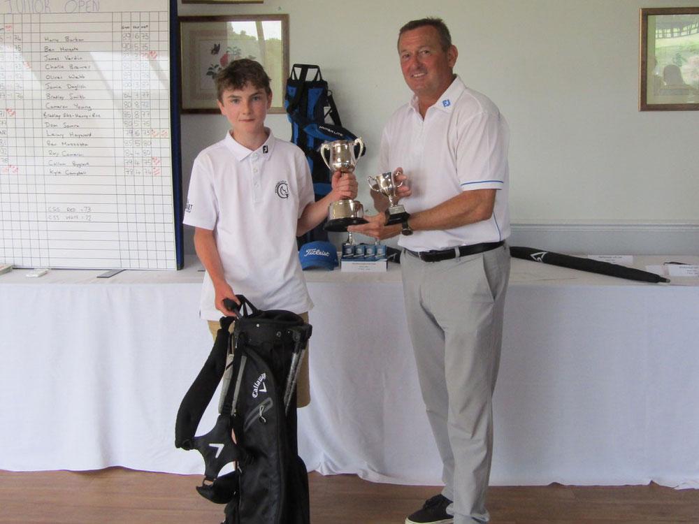 Finn Mulvey accepting the Marlborough Junior Open trophy from Simon Amor