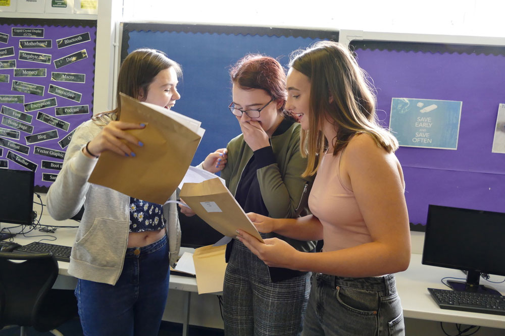 (l-r): Pewsey Vale students Esther Bailey, Libby Warman, and Katie Whiston open their GCSE results.  All three are going to go on to St Johns Sixth Form