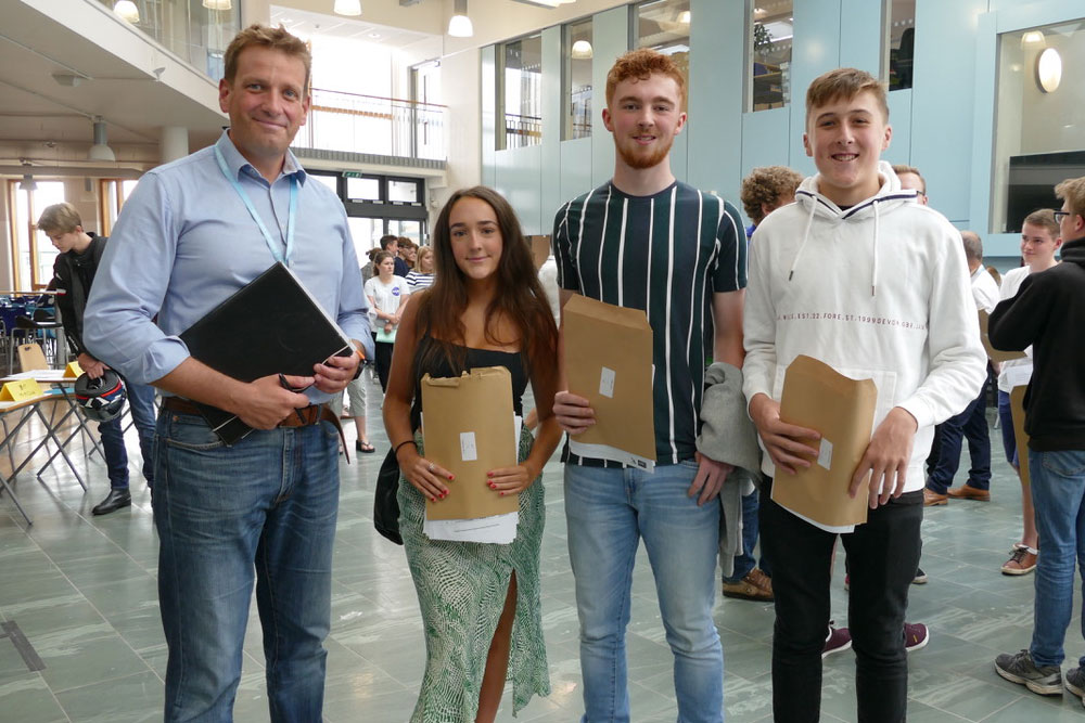 Ian Tucker, Principal of St John's with Holly Westbury, Alfie Smith and Oliver Rhoads