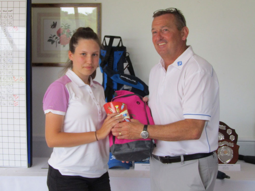 Jennifer Almond being presented with the Marlborough Junior Open prize by Simon Amor