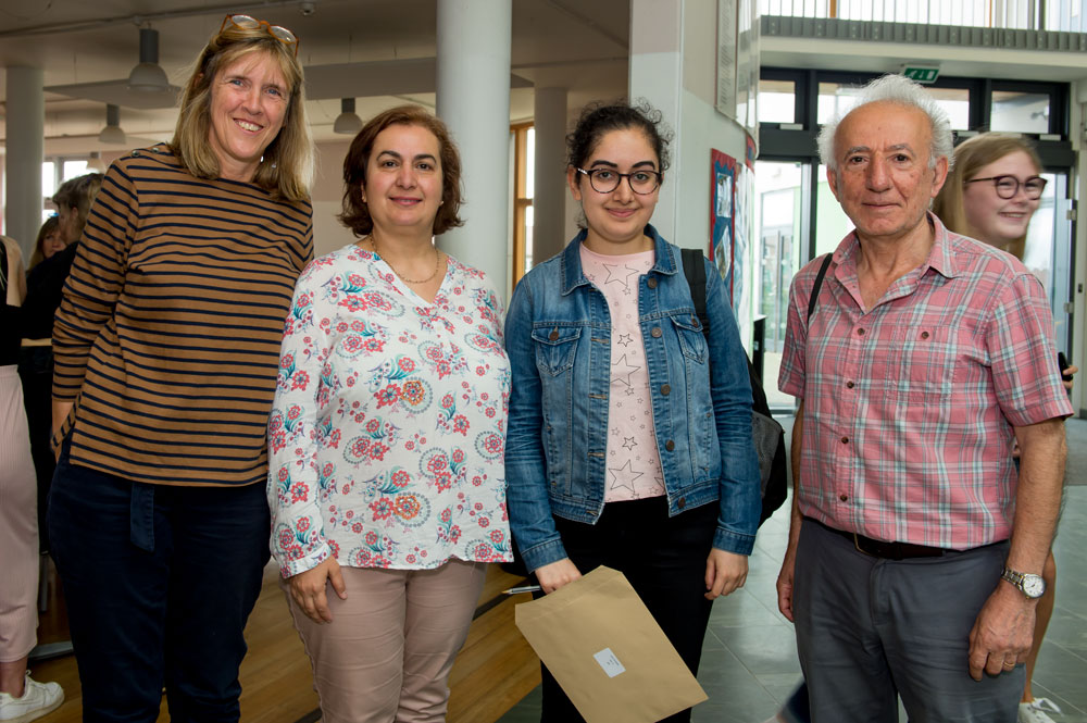 Annabelle Jarjis with parents Dr Raik (right) and Nemat Jarjis and Maths Tutor Juliet Packer celebrating Annabelle's achievement of 3 A* and one A