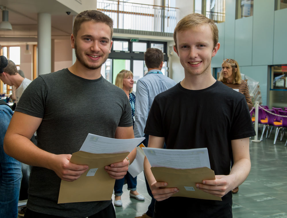Jamie Ponting (left) and Daniel Excell-Smith proudly hold their confirmations of grades