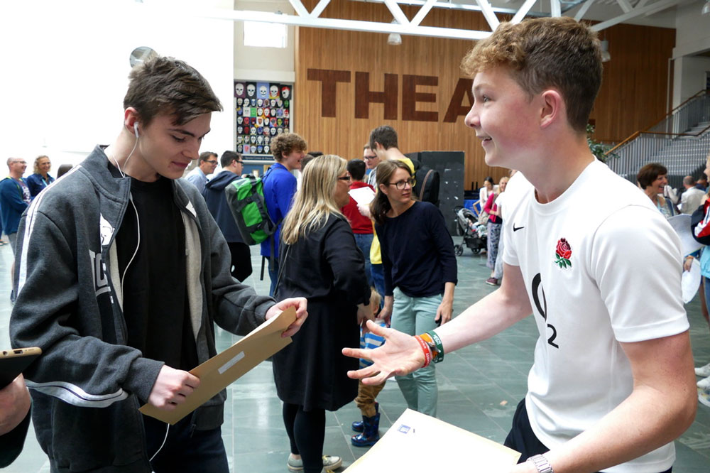 St Johns students Tom Jackson and Austin Wilson get excited about their GCSE results