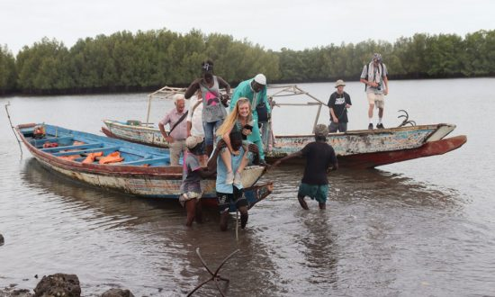 Day out on boats to Kunta Kinte island and a piggy back ride to shore on our return""