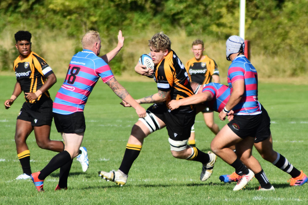 Tom Elbrow powering his way through the Sherborne defence