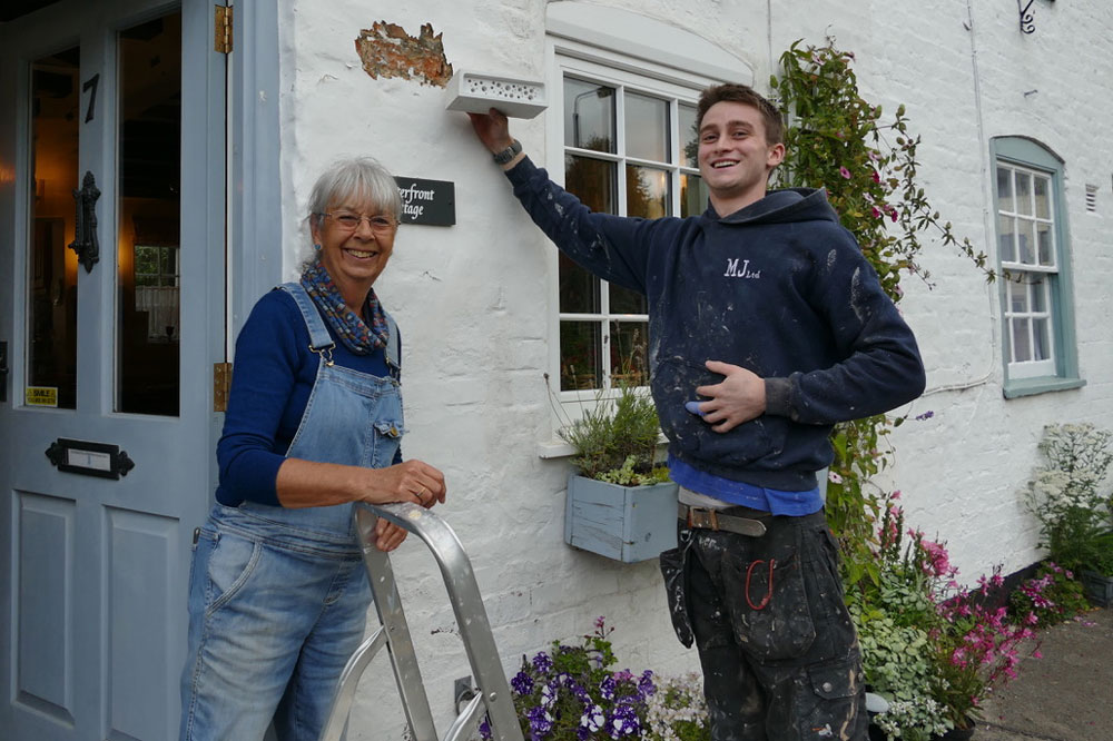 Val Compton with Kye Carty Barrett installing the bee brick