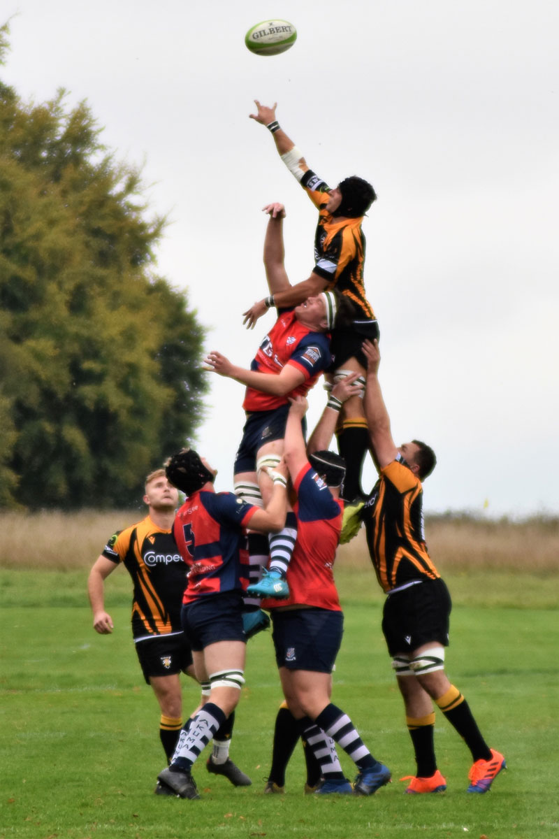 Ben Brownhall being lifted high into the sky