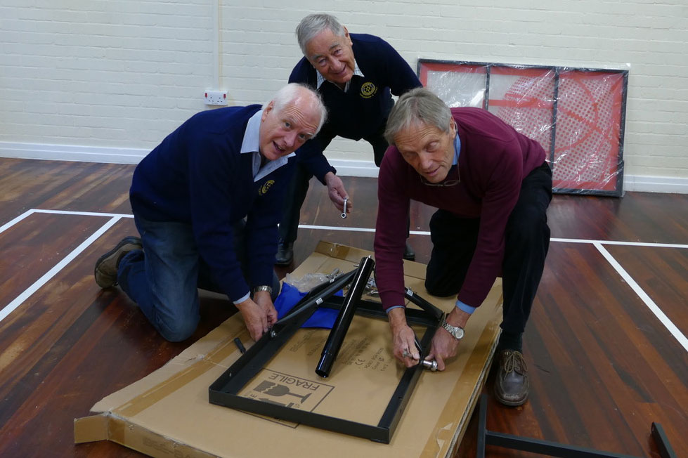 Martin Luxford, President of Marlborough and District Rotary with Jerry Hooper and Paul Cowan assemble the basket ball backboards