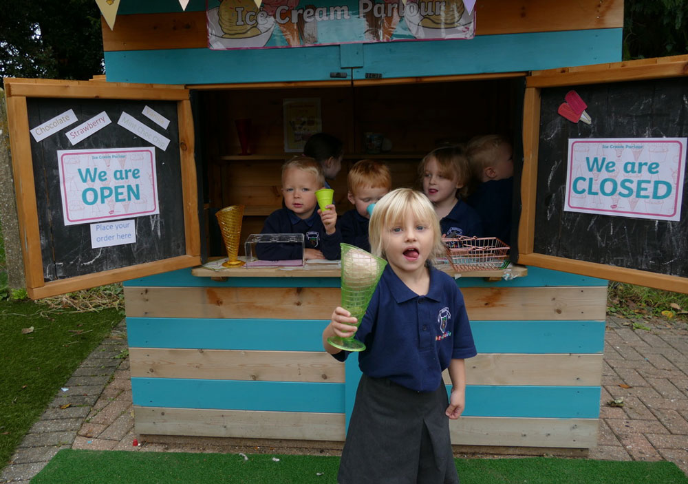 Pre School children playing in the ice cream parlour