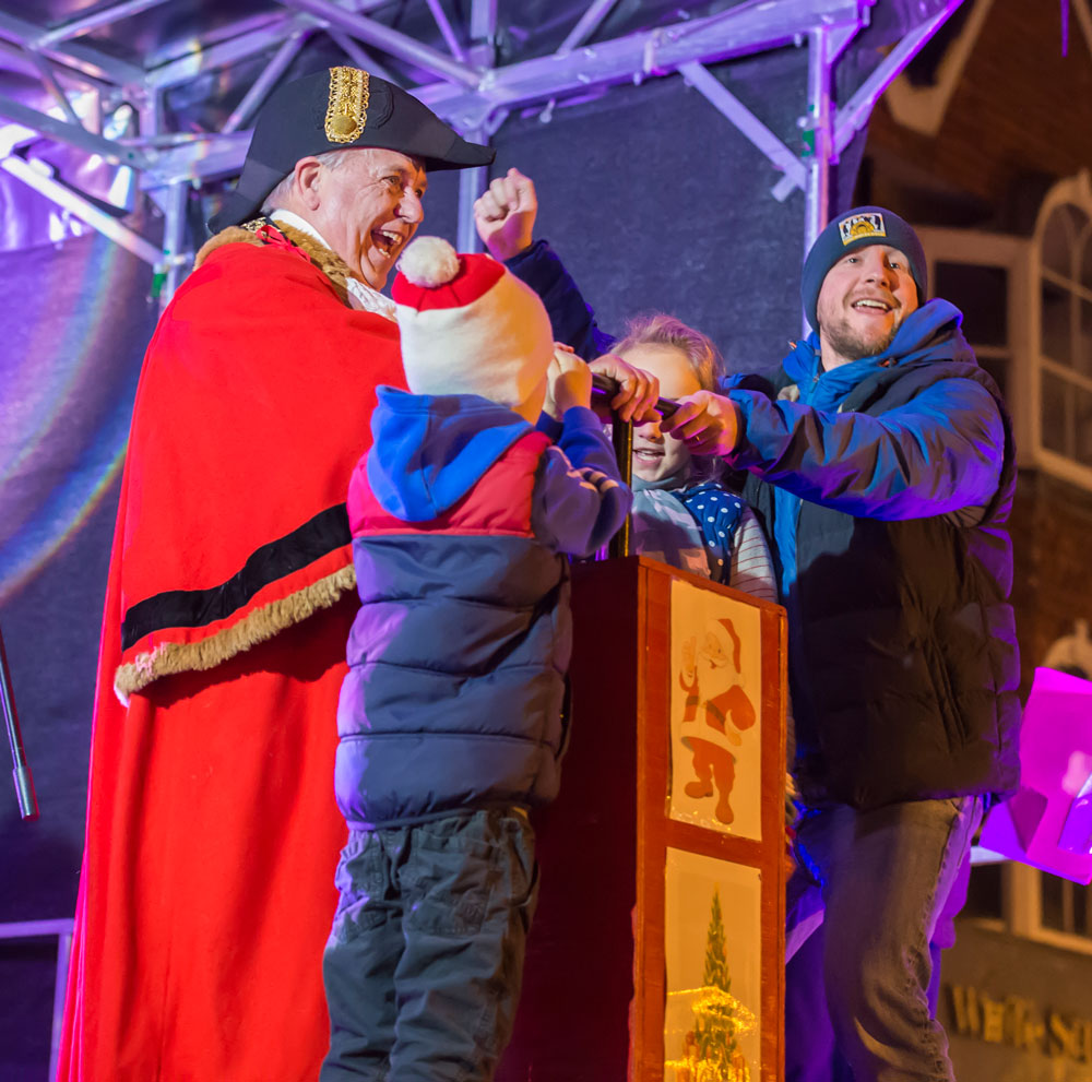 Mayor Mervyn Hall and Wiltshire Radio's Ben Prater switching on Marlborough's Christmas lights with a bit of help from Ben's kids in 2017