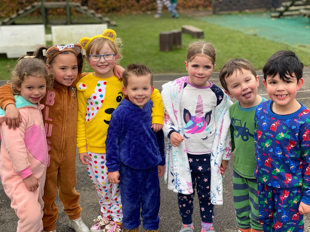 Cosy in pyjamas in the playground