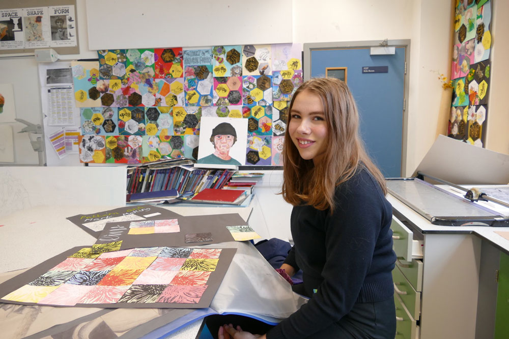 Prize winning art student Francesca Hutton with her GCSE Art work